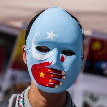 A. Merkel kaltina Kiniją žiauriu elgesiu su mažumų atstovais