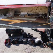 Nelegalūs migrantai iš Vietnamo slėpėsi vilkiko daiktadėžėse: tūnojo 15 žmonių