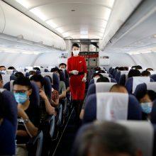 Pekine baiminantis viruso atšaukiami skrydžiai, uždaromos mokyklos