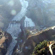Indijoje ledyno griūties sukeltų potvynių aukų padaugėjo iki 14, mažiausiai 170 žmonių dingo